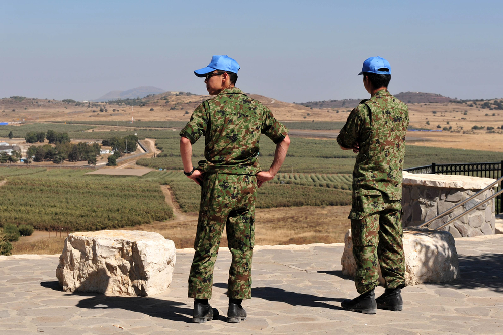 UNDOF soldiers examine the Israeli-Syrian border in Golan Heights, Israel. (Chameleons Eye / ShutterStock)