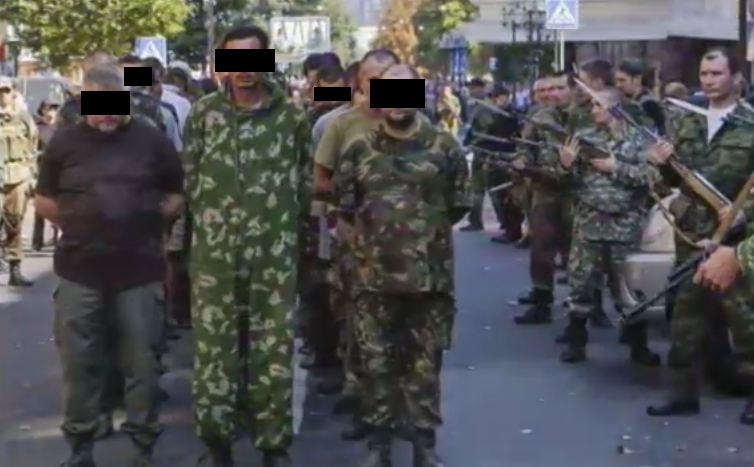 Rebels parades captured Ukrainian soldiers for the media. (Screengrab from Global News footage)