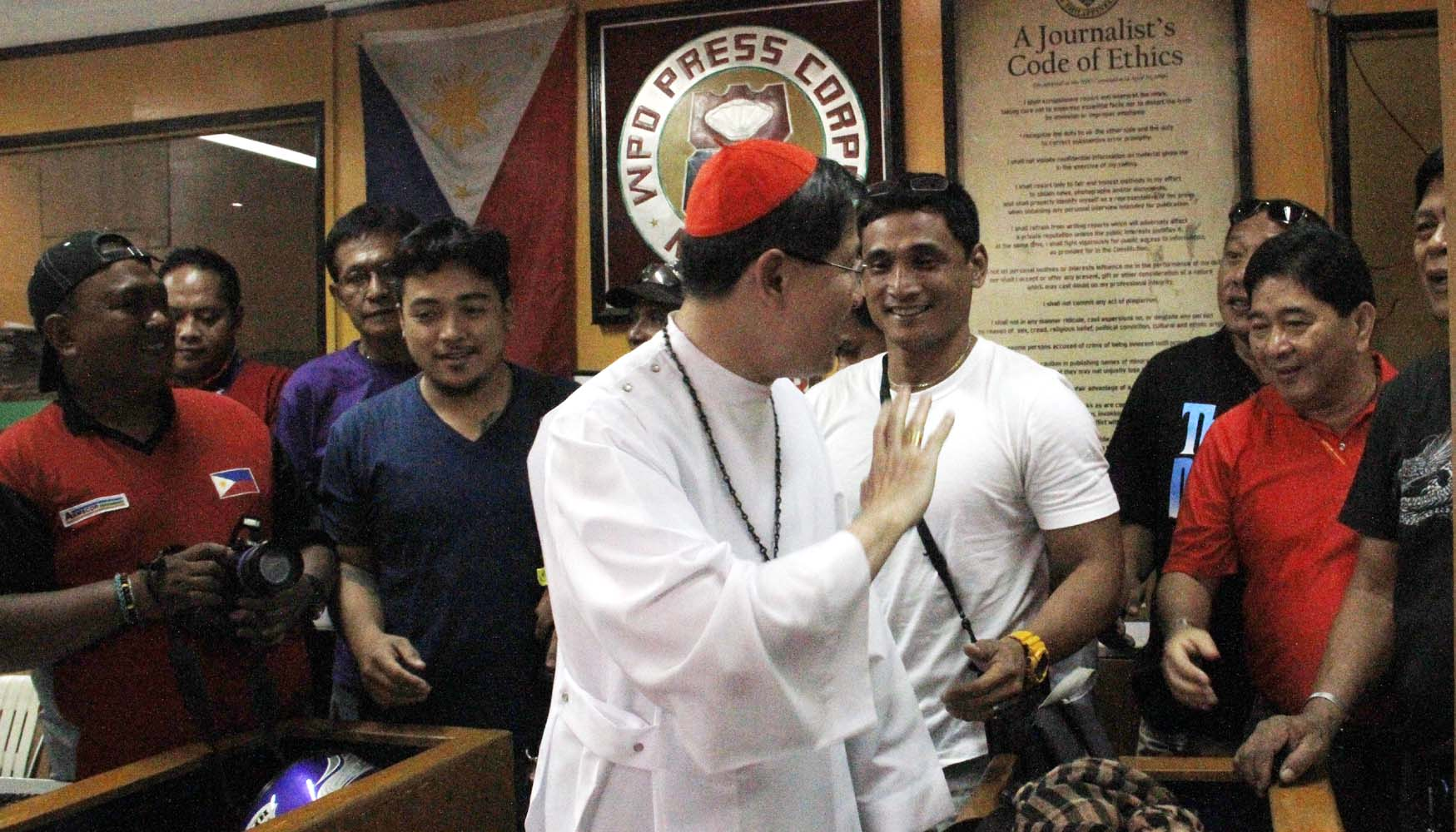His Eminence LUIS ANTONIO G. CARDINAL TAGLE visits the members of the Manila Police District Press Corps after officiating a Holy mass inside the MPD Detention Cell. He is the first Cardinal who visited the Manila Police District Headquarters on Saturday, August 23,2014, on United Nations Avenue, Manila (PNA photo by Avito C. Dalan)