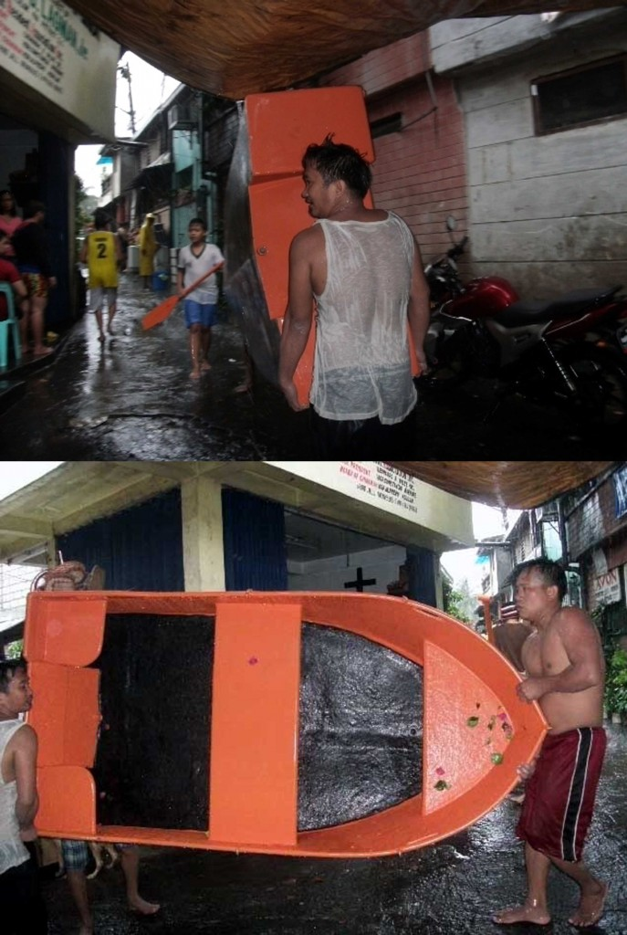 Unmindful of the cold weather amid heavy rainfall, some male residents of Barangay Kristong Hari in Quezon City volunteer to bring out four rubber boats from the barangay hall to be used in evacuating families whose houses were submerged partly in floodwater in low-lying areas of Dona Juana St. near the Roxas District Creek in Quezon City on Friday (Sept. 19, 2014). Some 1,000 families were transferred to safe evacuation sites. (PNA photos by Leilani S. Junio)