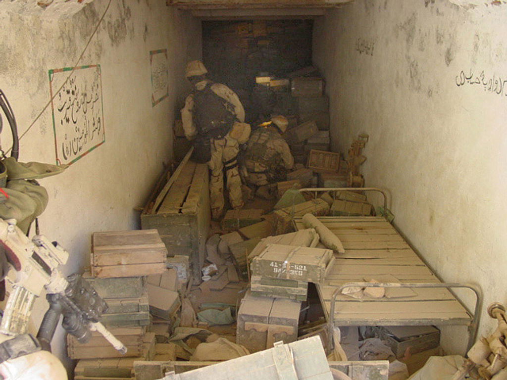 During a search and destroy mission, U.S. Navy SEALs discover a large cache of munitions in one of more than 50 caves explored in the Zhawar Kili area. U.S. Navy photo / Wikimedia Commons.
