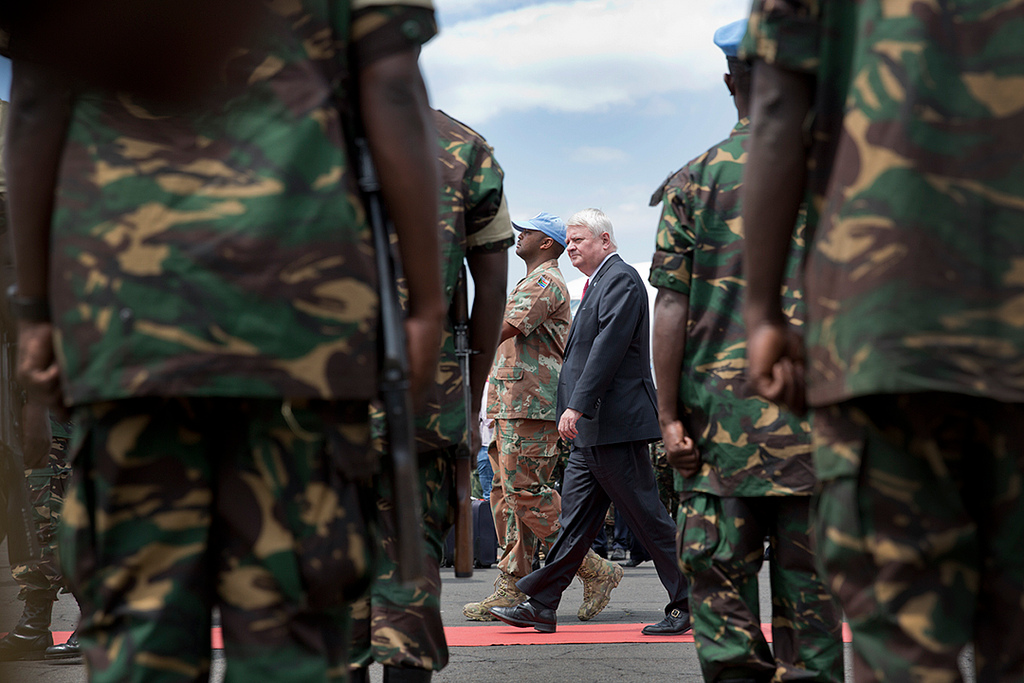 The UN Under-Secretary-General for Peacekeeping Operations, Hervé Ladsous (center and in a dark suit), is received with full military honors on his arrival in Goma, eastern D.R. Congo. Photo from MONUSCO / Sylvain Liechti / Flickr.