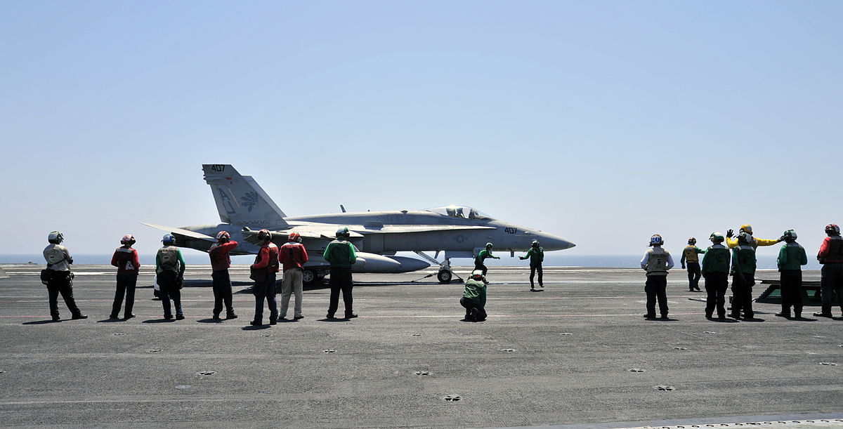 An American F/A-18C Hornet aboard the USS George H.W. Bush prior to the launch of operations over Iraq. Photo by Mass Communication Specialist 3rd Class Margaret Keith / U.S. Navy / Wikimedia Commons.