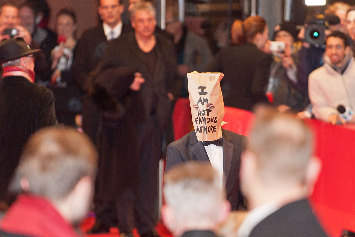LaBeouf wearing a paper bag over his head at the Berlin Film Festival. Photo by Siebbi / Wikimedia Commons.