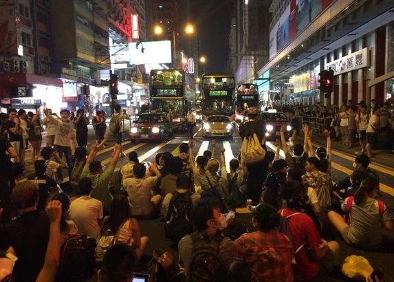 """Mong Kok protesters sitting down blocking Nathan Road, a hugely busy Kowloon thoroughfare. Quite a sight #HongKong"" (Photo courtesy of Katy Lee on Twitter)"