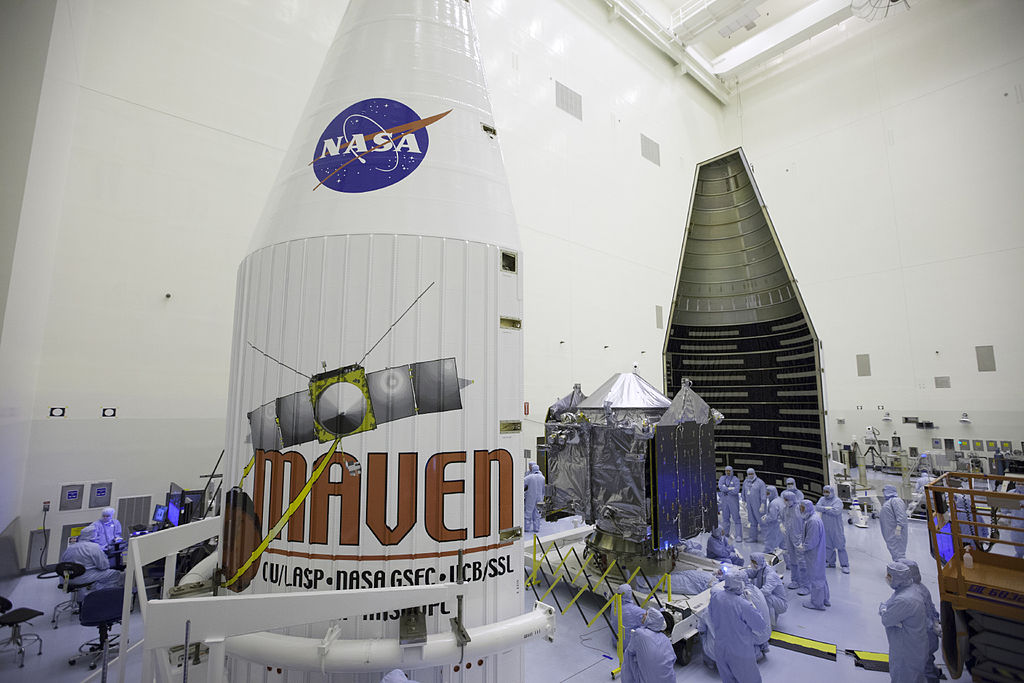 Inside the Payload Hazardous Servicing Facility at NASA's Kennedy Space Center in Florida, engineers and technicians prepare the Mars Atmosphere and Volatile Evolution, or MAVEN, spacecraft for encapsulation inside its payload fairing. Photo from NASA / Kim Shiflett.
