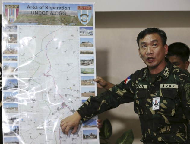 Commanding Officer of the Armed Forces of the Philippines Peacekeeping Operations Center, points to an area of a map where peacekeepers are stationed in Golan Heights. Photo courtesy of Aaron Favila.