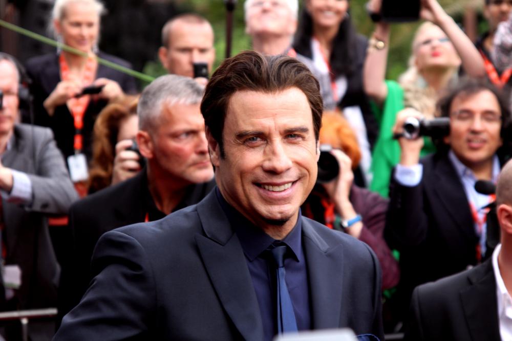 "Famous actor John Travolta arrived to present the film ""Killing Season"" at the International Film Festival, Karlovy Vary on June 28, 2013, Czech Republic (Aleš Studený / Shutterstock)"