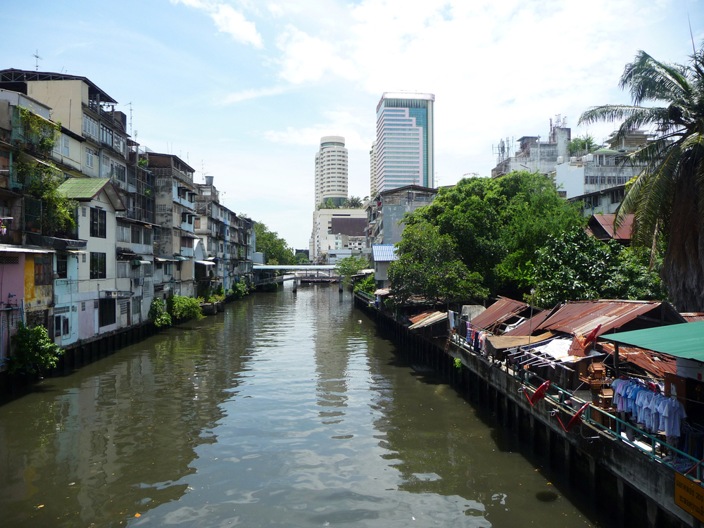 Low and high rise buildings in a waterfront in Bangkok, Thailand.