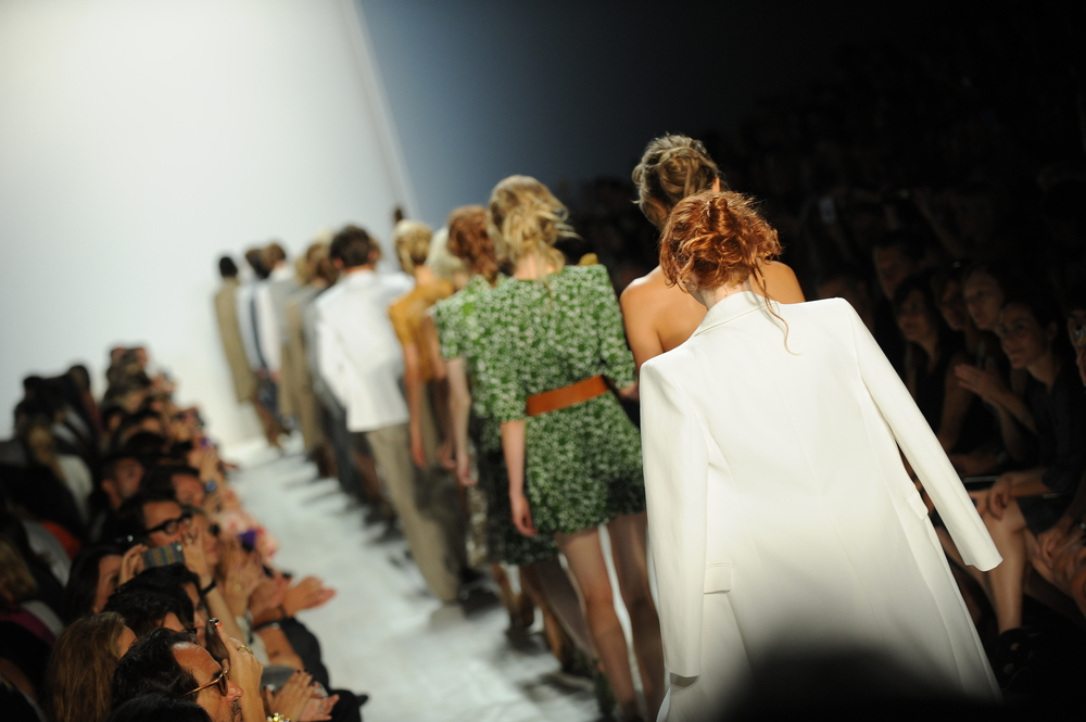 Models walk the runway finale at the Michael Kors show. Photo by Anton Oparin / Shutterstock.com.
