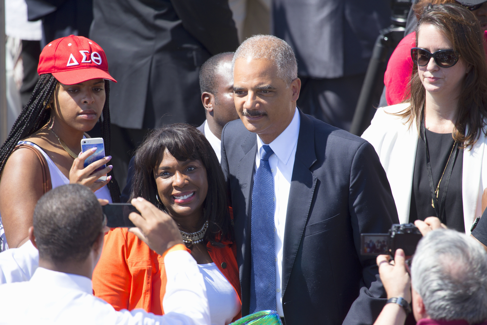 U.S. Attorney Eric Holder Jr. poses for pictures at the 50th Anniversary of the march on Washington and Martin Luther King's Speech, August 24, 2013, Lincoln Memorial, Washington, D.C. (Spirit of America / Shutterstock)