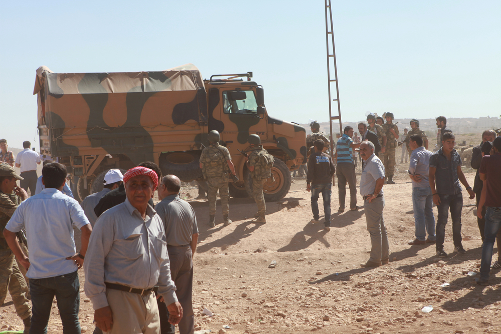 SURUC, TURKEY-SEPTEMBER 20, 2014: Turkey opened its border to Syrians fleeing the town of Kobane in fear of an Islamic State attack. Tens of thousands have fled to Turkey on September 20, 2014. (fpolat69 / Shutterstock)