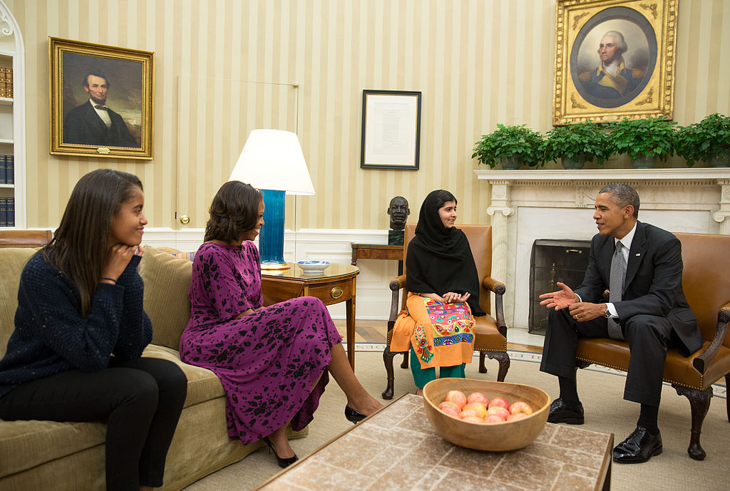 Barack Obama, Michelle Obama, and their daughter Malia meet with Malala Yousafzai in the Oval Office. White House / Flickr.