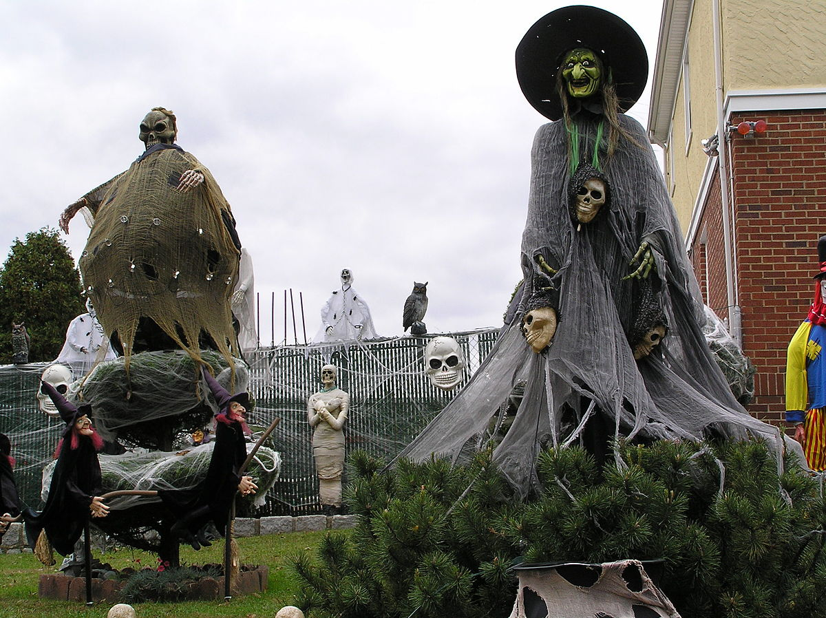 At Halloween, yards and public spaces may be decorated with traditionally macabre symbols including witches, skeletons, cobwebs, and headstones. Anthony22 / Wikimedia Commons.