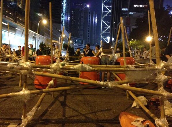 """""""#OccupyCentral bamboo barricades completed. Cement used to weigh the bamboos down."""" Photo courtesy of Phila Siu (@phila_siu) on Twitter."""