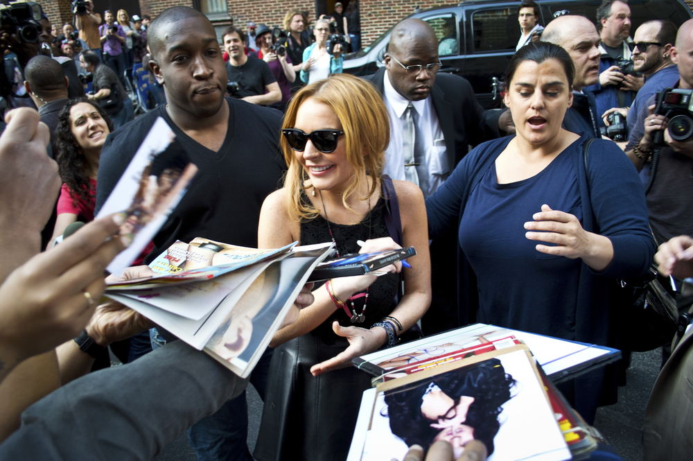 Lindsay Lohan greets fans after her David Letterman appearance outside the Ed Sullivan Theater. Andrew F. Kazmierski / Shutterstock.com.