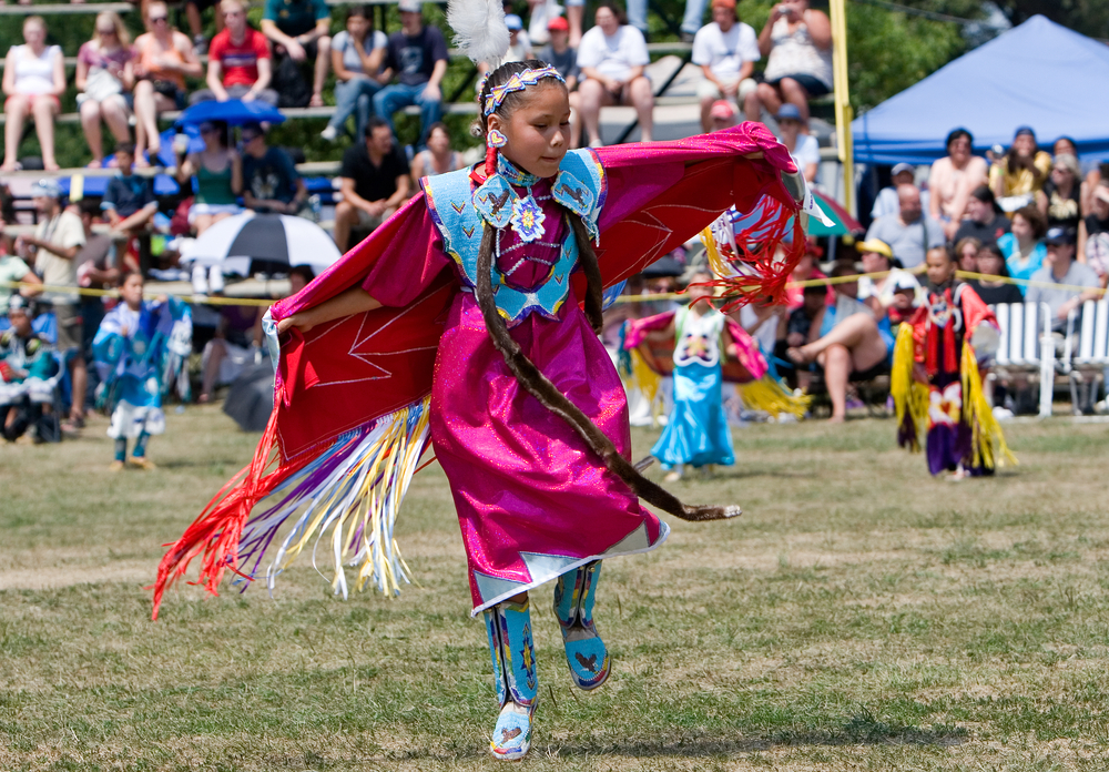 A young Shawl Dancer performs at the Grand River Champion of Champions Powwow  in Ohsweken, Ontario, Canada. wdeon / Shutterstock.com.