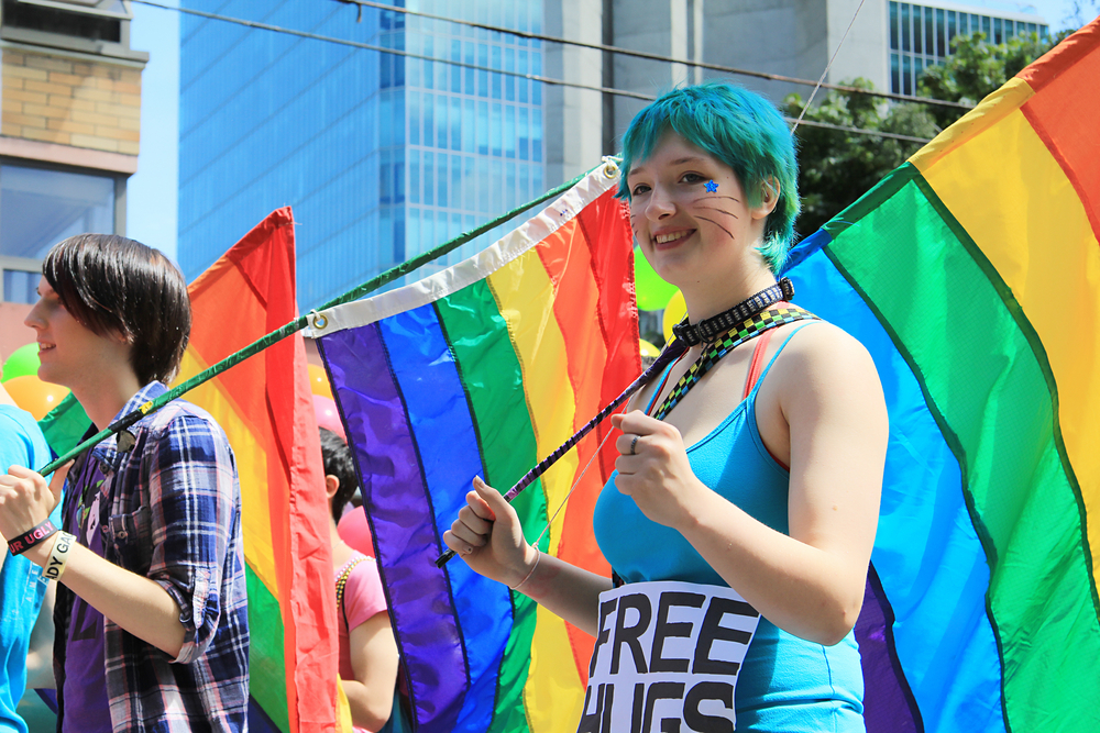olorfully dressed participants during the annual gay pride parade in Vancouver, B.C. Canada. Hannamariah / Shutterstock.com.