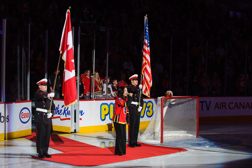 Heather Liscano performing the Canadian and American national anthems in front of Calgary Flames fans at the Saddledome.