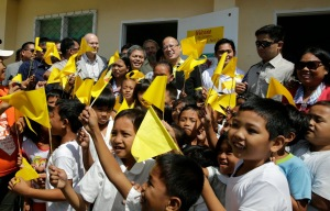 President Benigno S. Aquino III poses with pupils of the newly repaired classrooms of Guiuan East Central School in Barangay 8, Poblacion, Guiuan during the visit to the province of Eastern Samar on Friday (November 07). It was in Guiuan where super Typhoon Yolanda, the strongest typhoon ever recorded, made its first landfall on November 08, 2013. (Photo by Gil Nartea / Malacañang Photo bureau)
