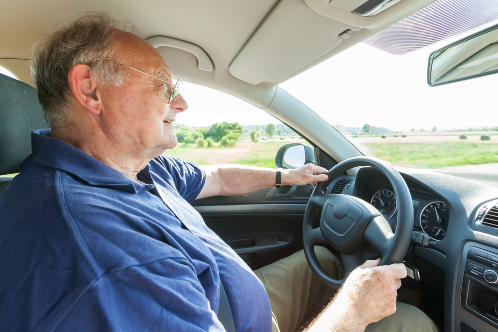 old man elderly senior citizen driving