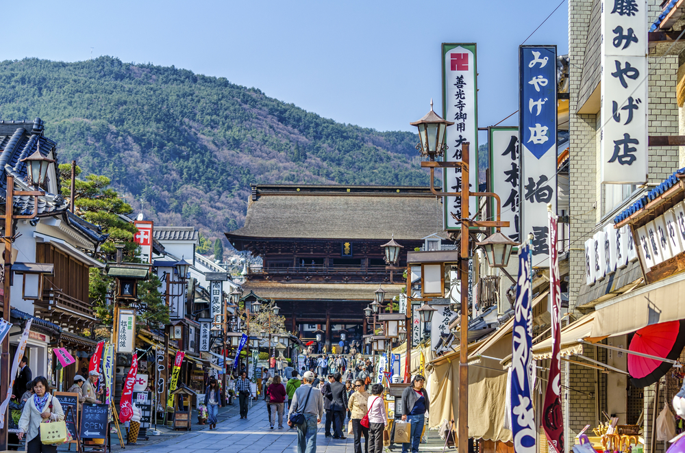 April,2014 :The street approach to Zenkoji temple is lined with shops selling local specialties and souvenirs, as well as small restaurants. (Korkusung / Shutterstock)