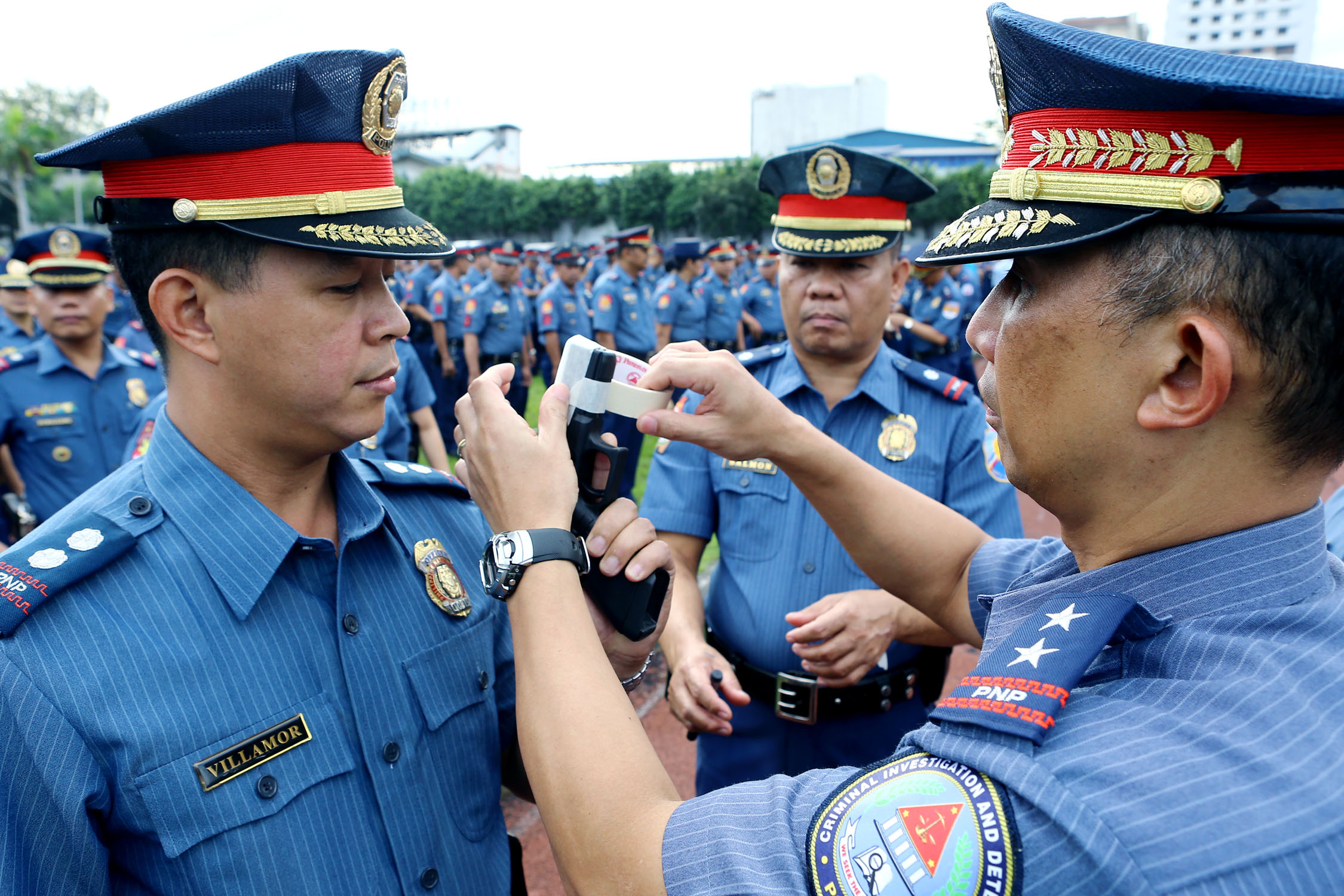 Criminal Investigation and Detection Group (CIDG) Director Benjamin Magalong leads the simultaneous gun muzzle-taping held on Monday (Dec. 22, 2014) at the Philippine National Police (PNP) headquarters in Camp Crame, Quezon City to assure the public that PNP personnel will not discharge their firearms as prevention of casualties and injuries during the Christmas and New Year celebrations. The traditional gun muzzling is conducted from the National Headquarters down to Police Regional Offices, Provincial Offices, City and Municipal Police Stations nationwide. (PNA photo courtesy of PNP-PIO)