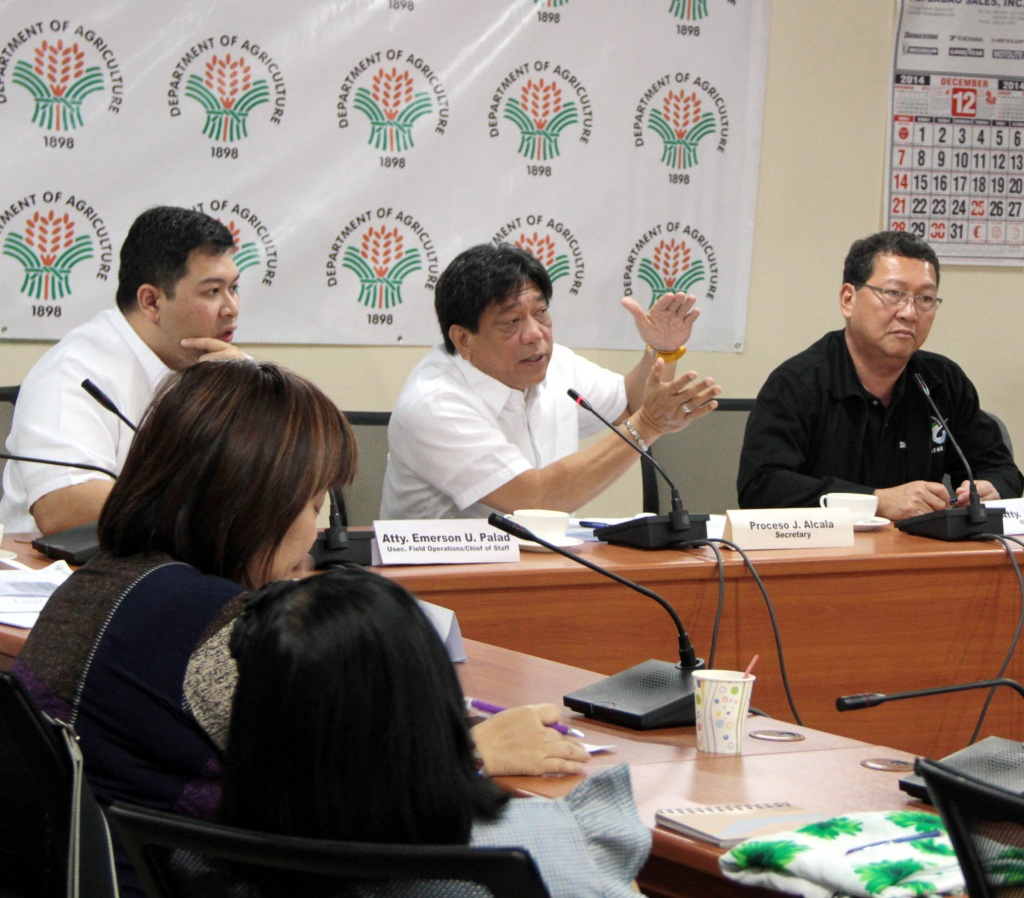"Department of Agriculture (DA) Secretary Proceso J. Alcala (center), flanked by DA Undersecretary Atty. Emerson Palad (left); and Bureau of Fisheries and Aquatic Resources (BFAR) Director Atty. Asis G. Perez, discuss updates on the effects of Typhoon ""Ruby"" (Hagupit) to the agriculture and fishery sectors on Monday (December 08, 2014) during a press conference at the DA office in Diliman, Quezon City. (PNA photo by Jess M. Escaros Jr.)"