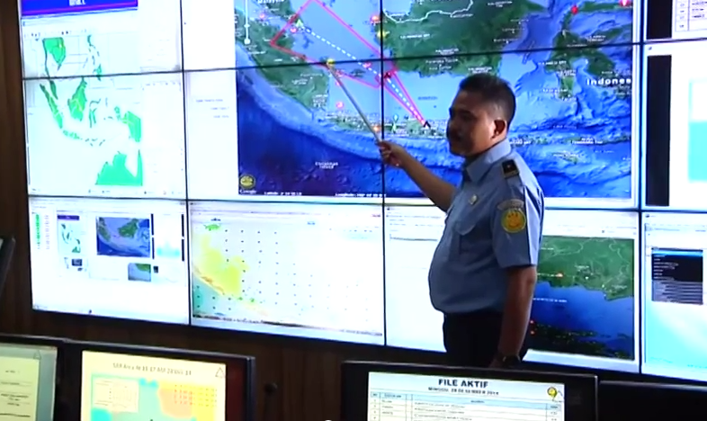 Officials discuss the route of missing AirAsia flight QZ 8501 (screenshot from Associated Press footage)