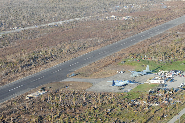 GUIUAN, Eastern Samar Province, Republic of the Philippines (Nov. 17, 2013) An HC-130 Hercules and other military aircraft sit on the tarmac at Guiuan airport waiting to airlift Philippine citizens in support of Operation Damayan. The George Washington Strike Group supports the 3d Marine Expeditionary Brigade to assist the Philippine government in response to the aftermath of Super Typhoon Haiyan/Yolanda in the Republic of the Philippines. (U.S. Navy photo by Mass Communication Specialist 3rd Class Peter Burghart / RELEASED)
