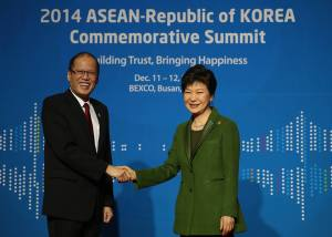 """President Benigno S. Aquino III greets Korean President Park Geun-Hye upon arrival for the 25th ASEAN-Republic of Korea Commemorative Summit 2014 at the Lobby of the Busan Exhibition and Convention Center (BEXCO) on Friday (December 12, 2014). With theme: """"Building Trust, Bringing Happiness,"""" reflecting ROK's commitment to strengthen its relationship with ASEAN through trust, which should result in happiness for the citizens of ASEAN and the ROK. The Summit covers the review of the ASEAN-ROK cooperation and its future direction, and the cooperation on non-traditional security issues with emphasis on climate change and disaster risk management. (Photo by Ryan Lim / Malacañang Photo Bureau)"""