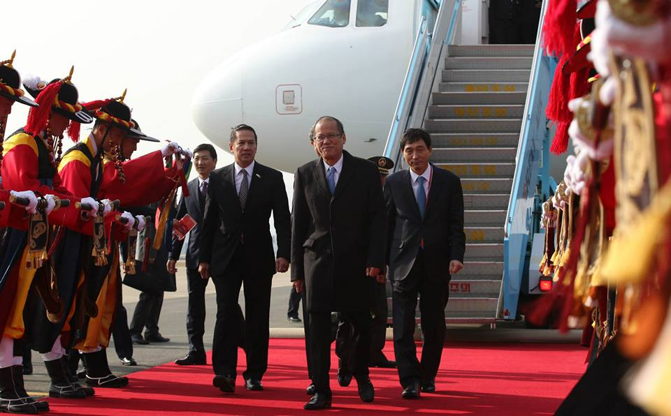 President Benigno S. Aquino III passes through the Honor Guards upon arrival at the VIP Terminal, 5th Mobility Wing of the Gimhae Air Base in Busan on Thursday (December 11, 2014) to join other leaders of ASEAN Member States (AMS) in attending the 25th ASEAN-Republic of Korea Commemorative Summit 2014. Also in photo is Philippine Ambassador to the Republic of Korea His Excellency Raul Hernandez. (Photo by Ryan Lim / Malacañang Photo Bureau)