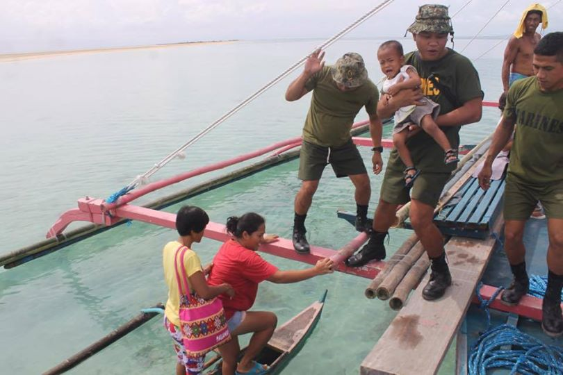 From Western Command Armed Forces of the Philippines: Philippine Marines assisting residents of Northern Palawan during the preemptive evacuation in preparation for #RubyPH. — December 8, 2014.