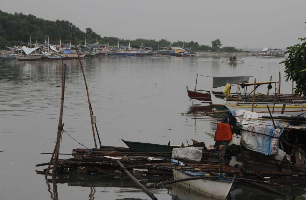 "Owners of motorized fishing boats park their vessels temporarily along the Freedom Island in Paranaque City to avoid the winds of Tropical Storm ""Ruby"" which is expected to pass south of Metro Manila Monday evening (Dec. 8, 2014). (PNA photo by Avito C. Dalan)"