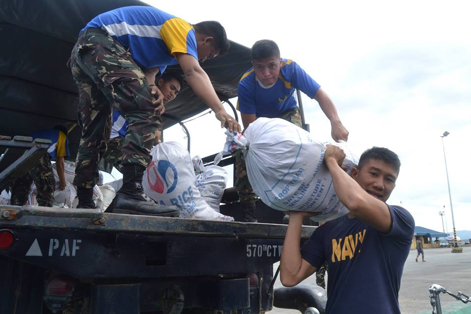 The Naval Forces West, crew of the BRP Apolinario Mabini (PS36), and the 570th CTW load relief goods from the DSWD, intended for the municipalities of Cuyo, Agutaya, and Magsaysay in Palawan. — December 7, 2014. (Photo from the Naval Forces West, Palawan)