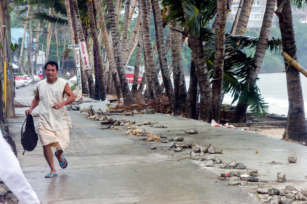 FLASHBACK? A man runs for safety as Supertyphoon 'Haiyan' lashes through Panay Island on November 8, 2013 (Richard Whitcombe / Shutterstock)