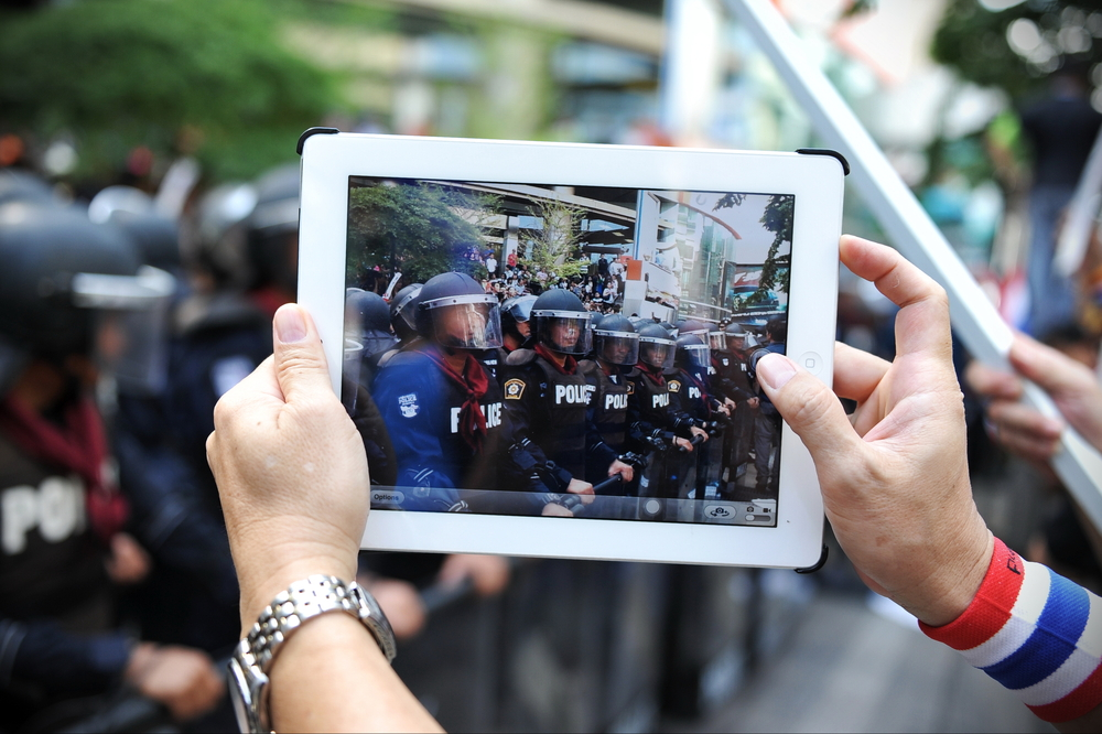 Protesting in the streets or screens? (1000 Words / Shutterstock)