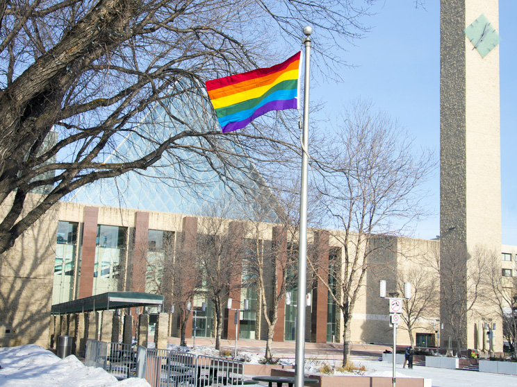 A rainbow pride flag is raised at City Hall in Edmonton, Alberta. Tyler McKay / Shutterstock.com