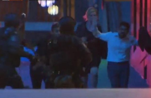 SYDNEY SIEGE A hostage runs to the police (screencap from Sky News footage)