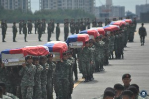 On the morning of January 29, 2015, the remains of the members of the PNP Special Action Force slain in Mamasapano arrived at the Villamor Air Base. The fallen PNP SAF were accorded arrival honors, led by the Secretary of the Interior and Local Government Mar Roxas, PNP Deputy Dir. Gen. Leonardo Espina, and AFP Chief of Staff Gen. Gregorio Catapang. (Presidential Communications Development and Strategic Planning Office)