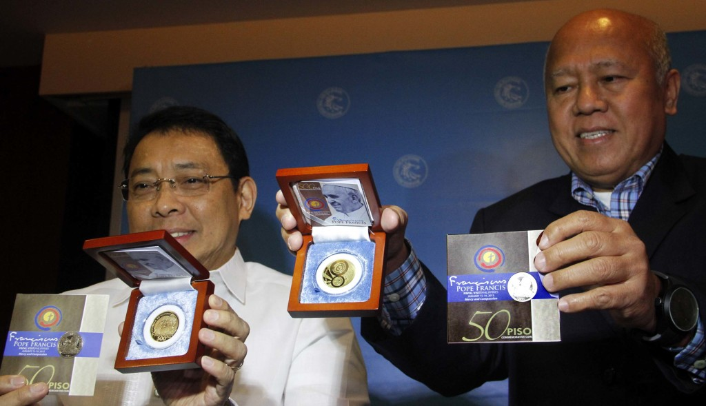 Bangko Sentral ng Pilipinas (BSP) Deputy Governors Diwa C. Guinigundo (left) and Vicente S. Aquino shows to the media the PhP50 and PhP500 Pope Francis Commemorative Coins issued by the BSP in connection with the Jan. 15-19, 2015 Papal Visit to the Philippines. BSP says both coins are legal tender and will be sold for PhP100 and PhP1,000, respectively, to cover production costs. (PNA photo by Avito C. Dalan)