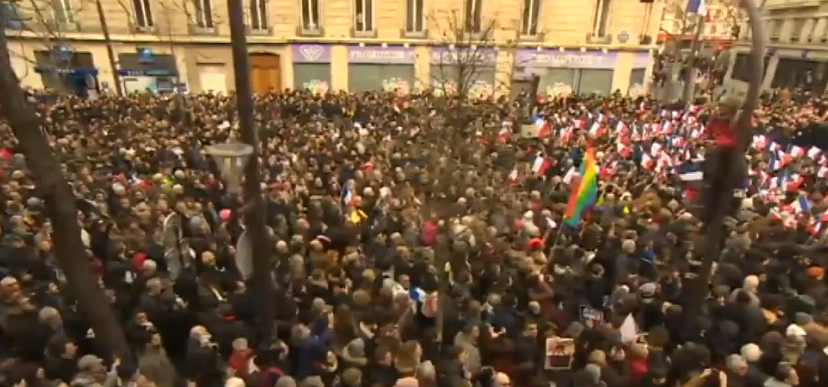 Thousands of people gather in Paris for the France Unity March (screenshot from BBC footage)