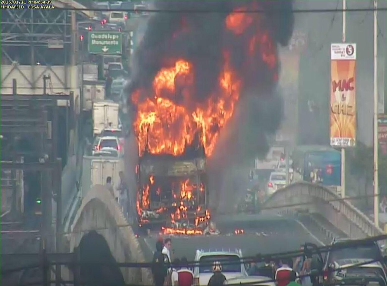 Passenger bus bursts into flames along Ayala flyover, Makati. (MMDA photo)