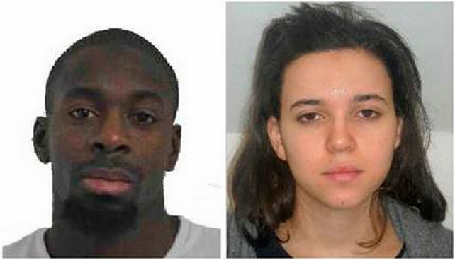Amedy Coulibaly, left, and Hayat Boumddiene, two suspects named by police as accomplices in a kosher market attack on the eastern edges of Paris on Friday, Jan. 9, 2015. (Prefecture de Police de Paris)