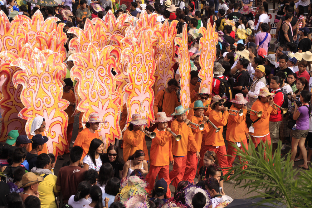 Filipino Catholic devotees dance and perform in the Annual Feast of the Child jesus or Sinulog Santo Nino Parade in Cebu City, Philippines. (Patrimonio Designs Ltd. / Shutterstock)