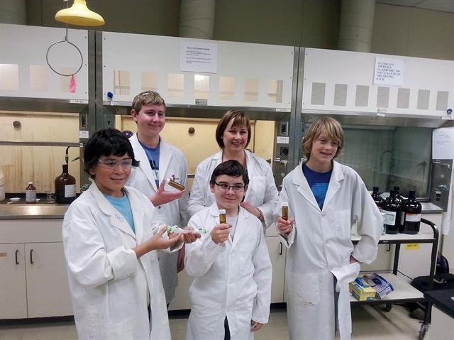 Hunter Galbraith, clockwise from back left, teacher Sharmane Baerg, Kieren O'Neil, Ryan Watson and Jordan Brown, the team are shown in this recent photo. A science project created by B.C. students that suffered a blow this fall when the rocket it was aboard exploded has finally launched into space. THE CANADIAN PRESS