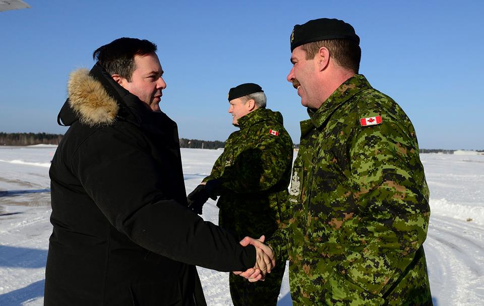 The Hon. Jason Kenney, Minister of National Defence, is greeted at the Petawawa Airport in Petawawa, Ontario, by the Canadian Army Sergeant Major, Chief Warrant Officer Michael Hornbrook, on February 13, 2015 (Photo by MCpl Melissa Spence, 4 Div - Canadian Army Public Affairs)