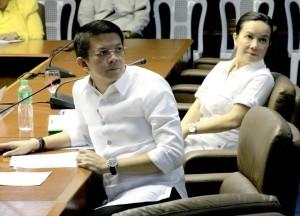Senator Francis 'Chiz' Escudero attends the senate hearing for the Mamasapano clash. Also in the picture, Senator Grace Poe. (Facebook photo)