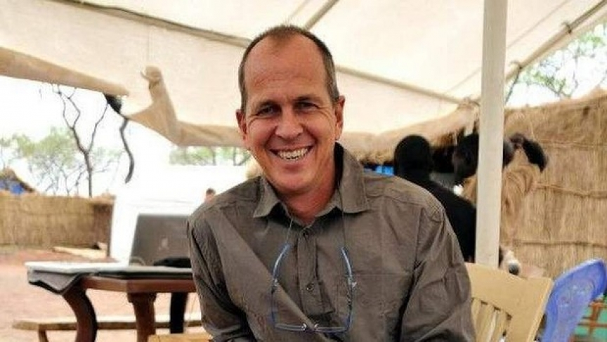 "Australian Journalist Peter Greste has been held in solitary confinement for over a year in Egypt for allegedly reporting ""fake news."" He was finally released on Sunday, Feb 1. (Simon O'Brien / PRI.org)"