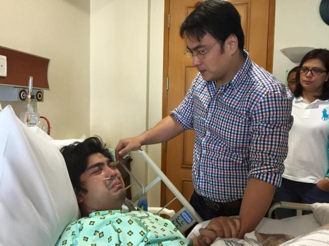 Sen. Bong Revilla comforts his son, Cavite Vice Gov. Jolo Revilla, on March 3, 2015 at the Asian Hospital and Medical Center, Muntinlupa City (Photo courtesy of Atty. Raymond Fortun and the office of Senator Ramon 'Bong' Revilla Jr.)